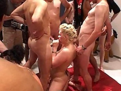 Two dirty whores sucking 12 hard cocks