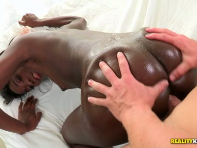 Ebony girl gets her bubled ass oiled and fucked