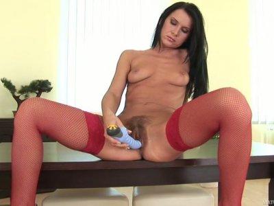 Slim brunette in red stockings Lola masturbates on the table
